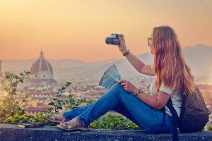 Young woman with a camera in Florence, Italy